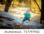 little baby in the autumn forest | Shutterstock . vector #717797932