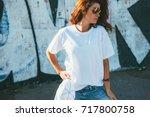model wearing plain white... | Shutterstock . vector #717800758