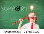 smart kid in classroom. child... | Shutterstock . vector #717813622
