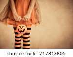 Stock photo funny child dressed witch costume kid waiting candy with pumpkin container halloween autumn 717813805