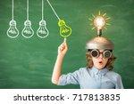 portrait of child in classroom. ... | Shutterstock . vector #717813835