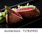 seared tuna with lettuce and... | Shutterstock . vector #717819352