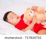 baby asia sleepping with her... | Shutterstock . vector #717820732