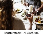 woman holding red wine glass in ... | Shutterstock . vector #717826786