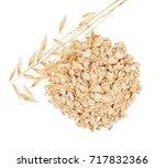 heap of oat flakes and ripe oat ... | Shutterstock . vector #717832366