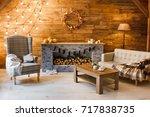 home comfort. armchair near the ... | Shutterstock . vector #717838735