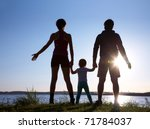 Silhouette Of A Young Family...