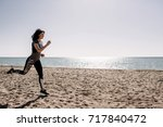 beautiful girl with sports... | Shutterstock . vector #717840472