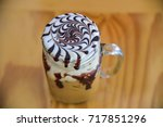 top view of iced chocolate with ... | Shutterstock . vector #717851296