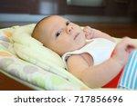 newborn naked baby boy lying in ... | Shutterstock . vector #717856696