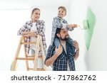 happy family renovating their... | Shutterstock . vector #717862762