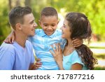 young family with adopted... | Shutterstock . vector #717877216