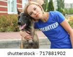 young female volunteer with... | Shutterstock . vector #717881902