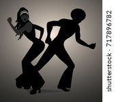 silhouettes of couple dancing... | Shutterstock .eps vector #717896782