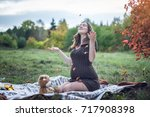 happy pregnant woman with a... | Shutterstock . vector #717908398