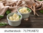 mashed potatoes in bowls on... | Shutterstock . vector #717914872