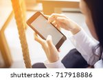 woman holding and using... | Shutterstock . vector #717918886