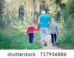 grandmother with kids walk in... | Shutterstock . vector #717936886