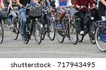 many people fast riding... | Shutterstock . vector #717943495
