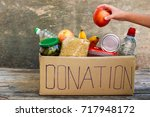 donation box with food. | Shutterstock . vector #717948172
