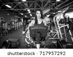 young fitness woman doing... | Shutterstock . vector #717957292