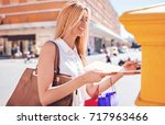 handsome smiling woman sending... | Shutterstock . vector #717963466