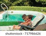 children sunbathe near the pool | Shutterstock . vector #717986626