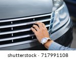driver checking the car before... | Shutterstock . vector #717991108