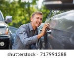 driver checking the car before... | Shutterstock . vector #717991288