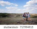 Stock photo group of friends traveler looking on the map and plan to trekking and adventure in the forest 717994915