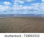 tide out at a beach on the isle ... | Shutterstock . vector #718001512