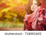 autumn woman in autumn park...   Shutterstock . vector #718001602