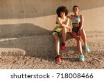 two happy fitness girl relaxing ... | Shutterstock . vector #718008466