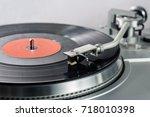 vinyl player. vinyl plate and... | Shutterstock . vector #718010398
