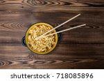 instant noodles in wooden bowl... | Shutterstock . vector #718085896
