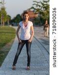 portrait of woman in the city... | Shutterstock . vector #718090036