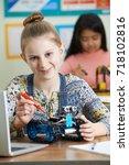 portrait of female pupil in... | Shutterstock . vector #718102816