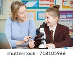 teacher with female student... | Shutterstock . vector #718105966