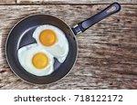 fried eggs in a frying pan....   Shutterstock . vector #718122172