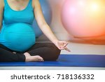 pregnant woman doing a yoga in... | Shutterstock . vector #718136332