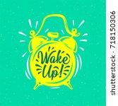 wake up   inscription on alarm... | Shutterstock .eps vector #718150306