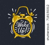 wake up  inscription on gold... | Shutterstock .eps vector #718150312