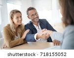 mature couple meeting real... | Shutterstock . vector #718155052