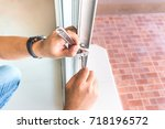 locksmith try to repair old... | Shutterstock . vector #718196572