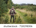 hunter with a backpack and a... | Shutterstock . vector #718198306