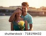 young boyfriend is giving... | Shutterstock . vector #718198432