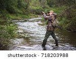 hunter with a backpack and a... | Shutterstock . vector #718203988