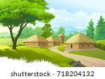 A beautiful village with farmlands, trees, meadows and with mountains in the background