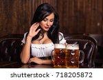 oktoberfest woman wearing a... | Shutterstock . vector #718205872