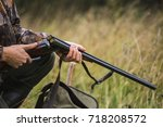 hunter with a backpack and a...   Shutterstock . vector #718208572